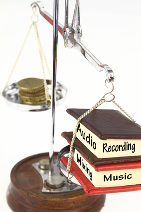 audio and mixing books on a scale with money